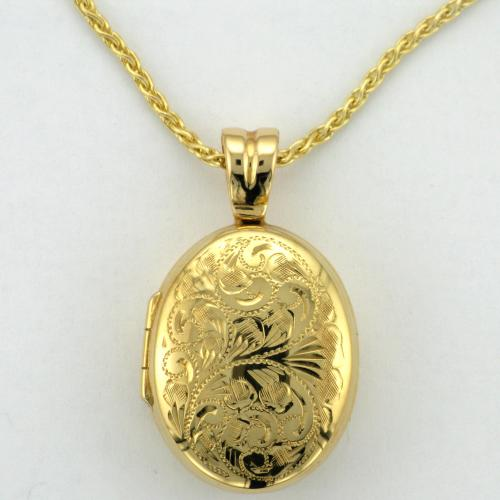 14k yellow gold locket with four photo frames.