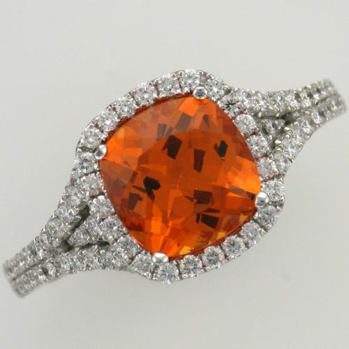 18k white gold spessartite garnet and diamond ring.