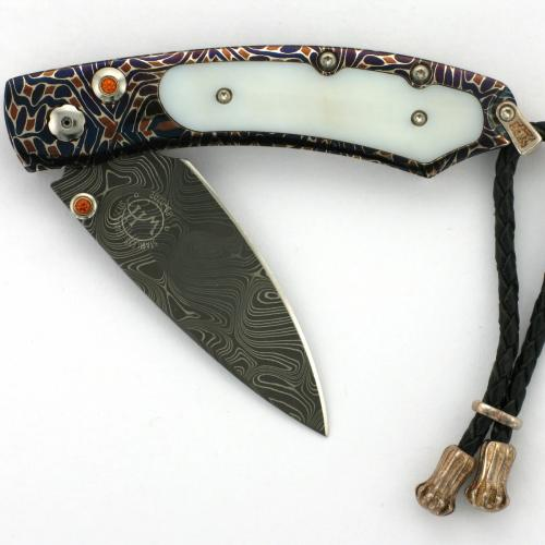 Limited edition 19/20 William Henry knife with fossil walrus inlay and accented with citrine.