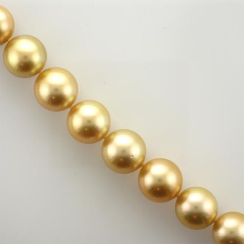 Single strand of golden pearls